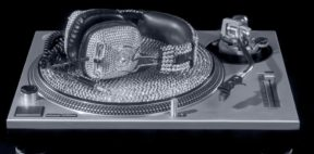 expensive crystal dj headphones and turntable