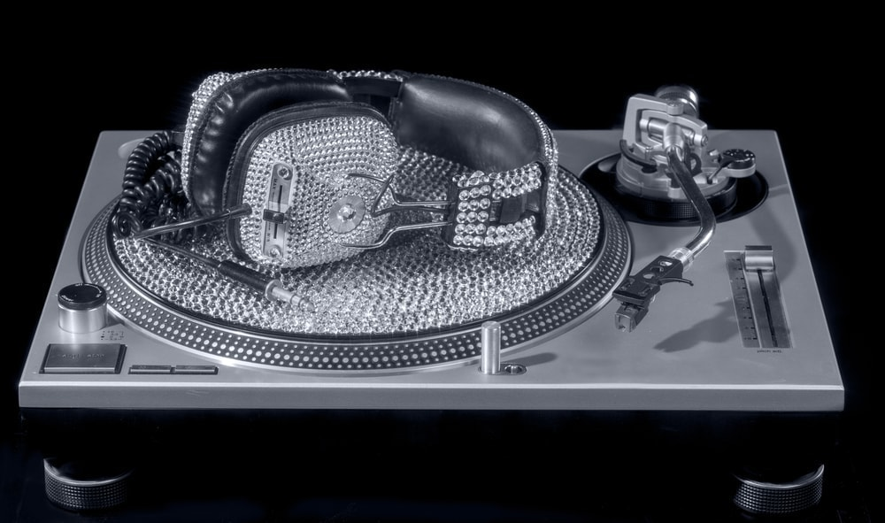 expensive crystal dj headphones and turntable