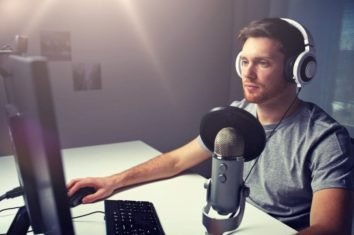man listening to recording of his electronic drums on his pc