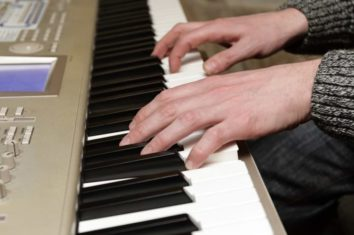 a person playing on their digital piano