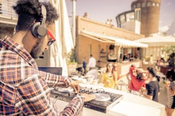 DJ playing music outside at a party