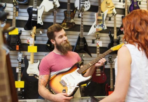 man selling an electric guitar