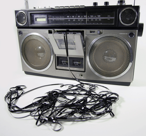 Retro boombox with tape coming out of it