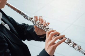 A person playing a reverse flute