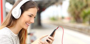 girl with headphones listening to music