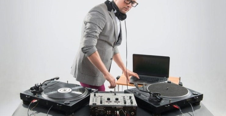 a beginner dj playing his equipment
