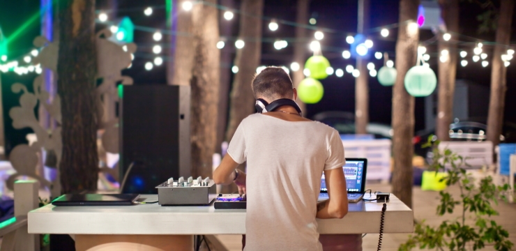 a dj playing at a beach party