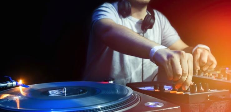 a dj using a vinyl record mixer