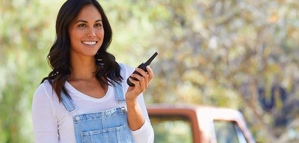 a girl with a radio in her hand