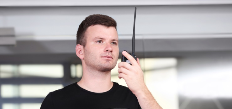 a guy talking to his Two-Way Radio