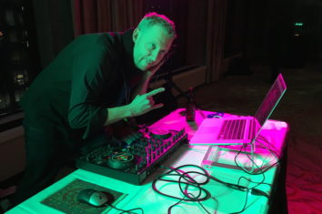 a man making music with a dj controller