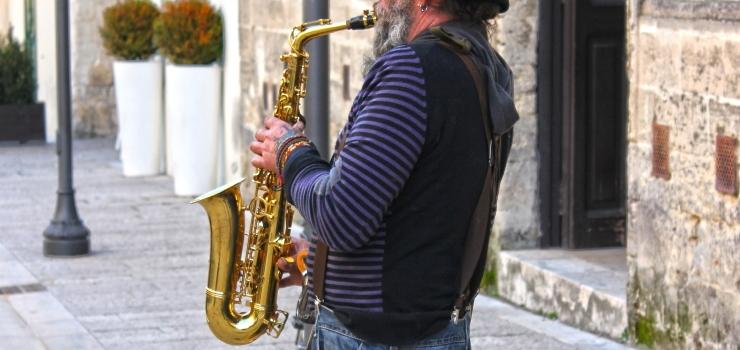 a man playing his alto saxophone