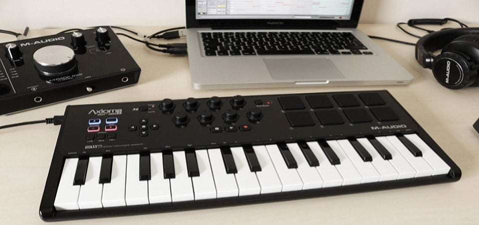 a midi keyboard connected to a computer