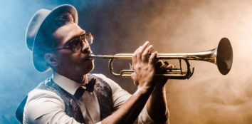 a musician playing his trumpet featured image