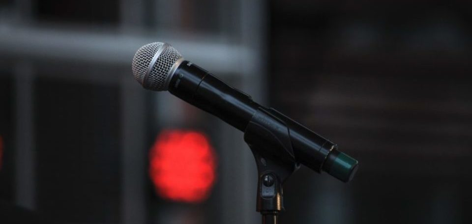 a wireless microphone in its stand