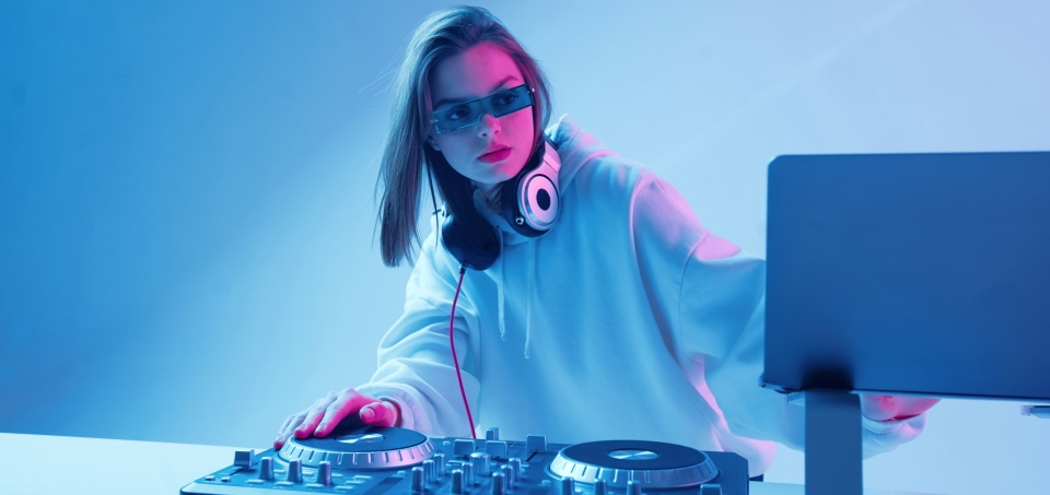 a woman mixing music with a dj controller