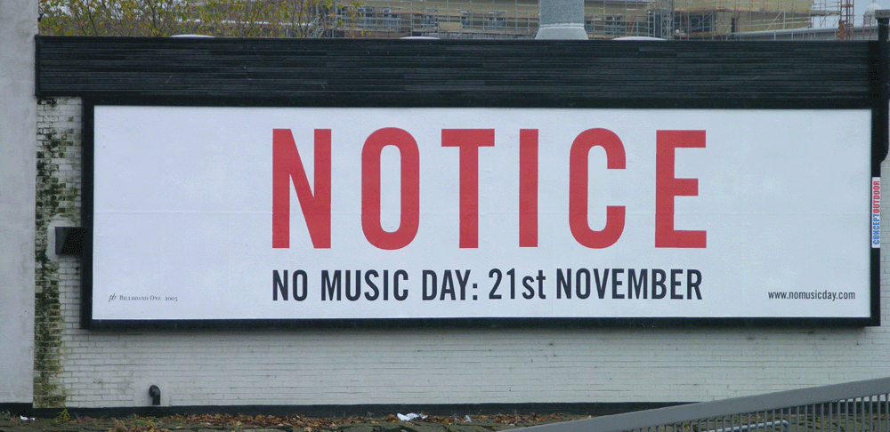 advertising billboard with no music day written on it