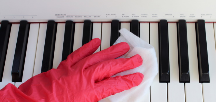 cleaning the keys of a piano