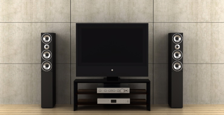 television with one floor standing speaker each side of it