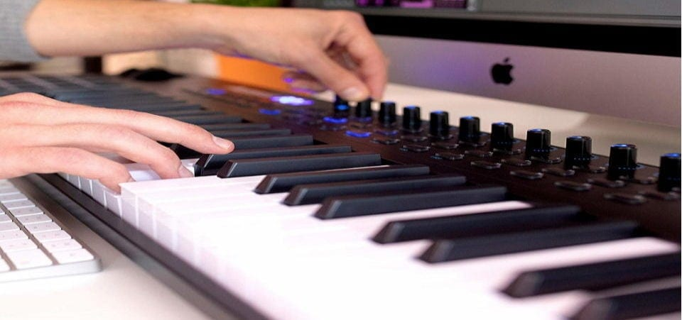 the hands are on the midi keyboard