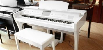 there are two digital pianos in the room