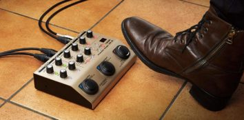 Somebody using their foot on a vocal processor