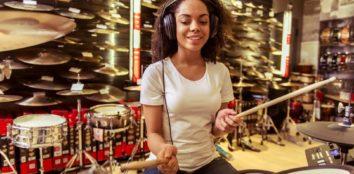 A woman playing an electronic drum set